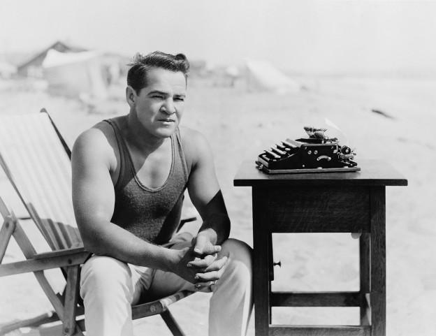 Man sitting next to typewriter
